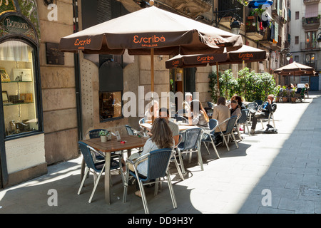 street cafe with umbrellas in Barcelona - Stock Photo