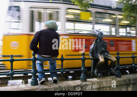 Kiskiralylány statue in front of a tramway. Budapest, Hungary. - Stock Photo