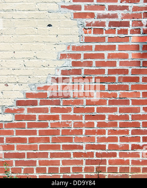 An old red brick wall. Can be used as a background. - Stock Photo