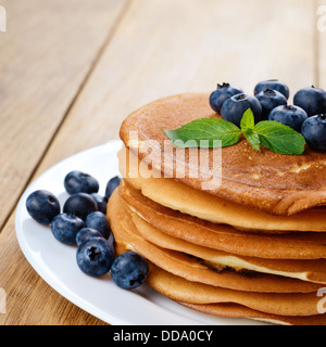 Ready to eat pancakes with blueberries on the white plate - Stock Photo