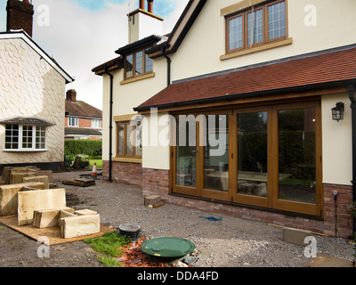 self building house, hard landscaping, sandstone patio paving slabs of new-built property - Stock Photo