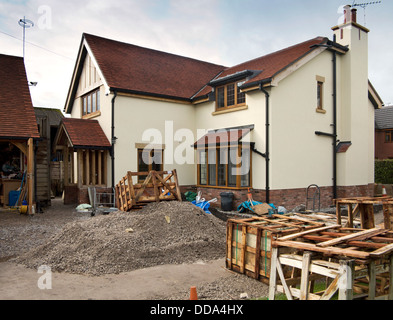 self building house, hard landscaping, pallets of sandstone paving slabs around edge of new-built property - Stock Photo