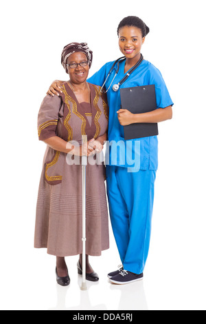beautiful African nurse and senior patient isolated on white - Stock Photo