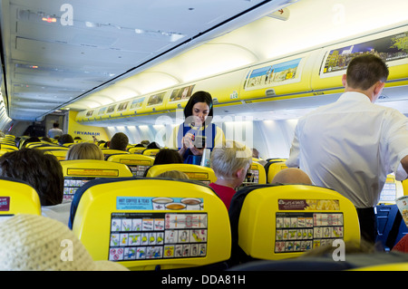 Cabin of a ryanair Airbus 320 aircraft. - Stock Photo