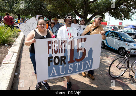 Austin, Texas USA: Fast-food workers and sympathizers march joining other U.S. cities protesting  low restaurant - Stock Photo