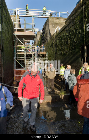 People inside a drained lock chamber, walking round & looking at renovation work - open day, Bingley's Five Rise - Stock Photo