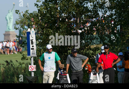 Aug. 25, 2013 - Jersey City, New Jersey, U.S - August 25, 2013: Tiger Woods (USA) prepares to tee-off on the 16th - Stock Photo