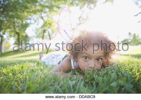Portrait of cute little wearing fairy wings - Stock Photo