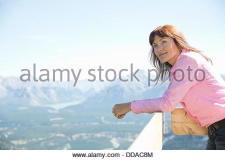 Woman looking out on mountain view - Stock Photo