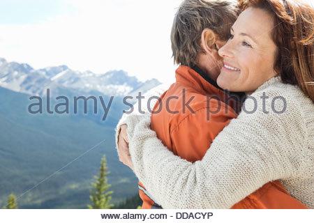 Romantic mature couple embracing outdoors - Stock Photo