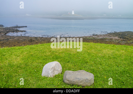 A view from Lubec, Maine, across the border between Canada and the United States, at the Mulholland Point lighthouse. - Stock Photo