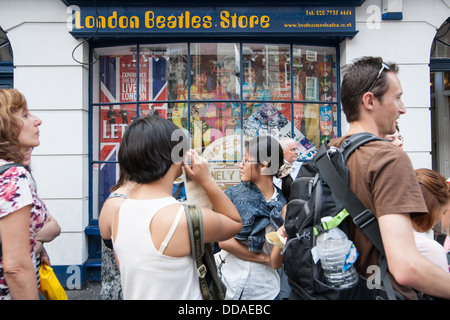 People outside the Beatles Store in London 'London Beatles Store'. - Stock Photo