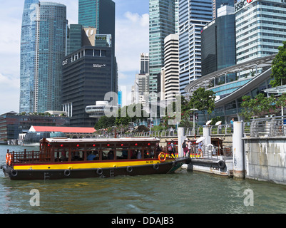 dh Marine Bay DOWNTOWN CORE SINGAPORE Bumboat cruise tours pier jetty Singapore water taxi boats skyscrapers - Stock Photo