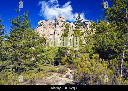 Brown Cliffs in La Pedriza Regional Park Cuenca Alta del Manzanares Madrid Spain - Stock Photo