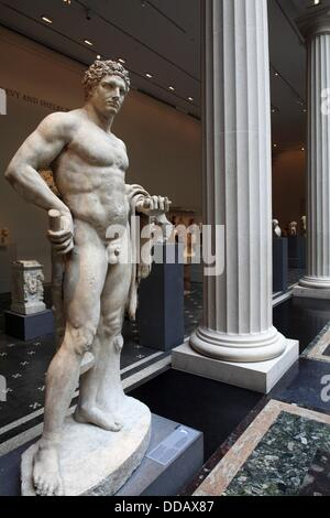 The marble statue of a youthful Hercules from Roman Flavian period display in the exhibition hall of Greek and Roman - Stock Photo