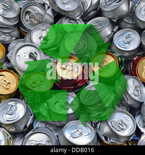 Crashed beer cans and recycling sign. Waste recycling. - Stock Photo