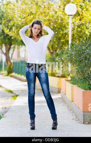 Tall young woman is posing - Stock Photo