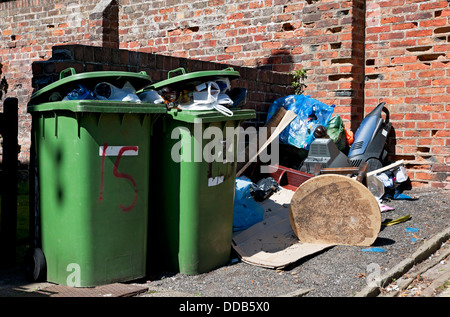 Full household recycling waste wheelie bins and fly tipping rubbish England UK United Kingdom GB Great Britain - Stock Photo