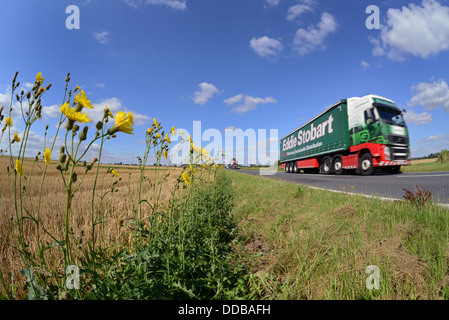 lorry angle view of lorry traveling along country road near Leeds Yorkshire United Kingdom - Stock Photo