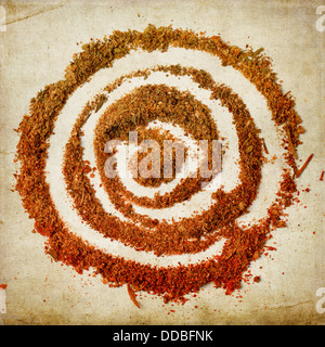 Top view on spiral of spices over textured background - Stock Photo