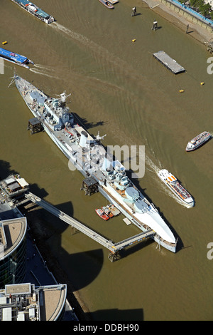 aerial view of HMS Belfast moored up as a museum in the River Thames in London - Stock Photo