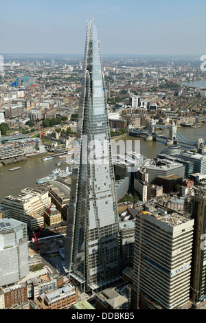 aerial view of the Shard and Tower Bridge over The Thames in London - Stock Photo