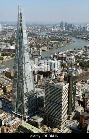 aerial view of The Shard, Tower Bridge, River Thames and Canary Wharf - Stock Photo