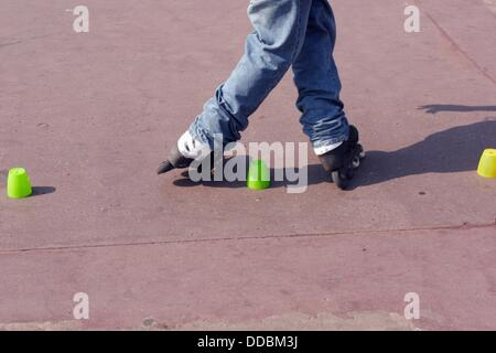 Roller blader performing tricks on Promenade des Anglais in Nice France - Stock Photo