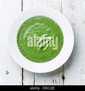 Spinach soup in white bowl - Stock Photo