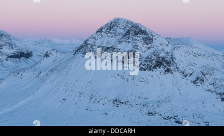 The view towards snow- covered Cul Beag from Sgorr Tuath with beautiful post sunset colours, Scottish Highlands, - Stock Photo
