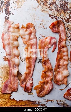 Crispy fried bacon background - Stock Photo