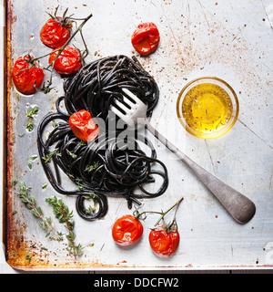 Black spaghetti with tomato sauce - Stock Photo