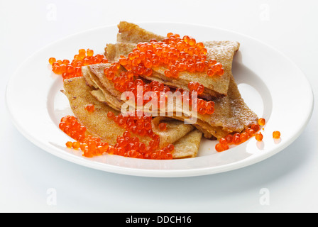 Pancake with red caviar on white background - Stock Photo