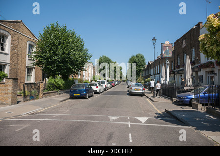 Typical street in in East London, terrace houses many subject to re-gentrification with English pub amongst them. - Stock Photo