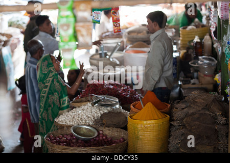 A customer browses in the Central municipal market selling fruits, food and spices  in Srimongol, Syhlet Division - Stock Photo