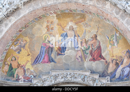 Religious painting on the front door of St. Marco Church, Venice Italy - Stock Photo