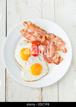 Eggs and bacon with tomato for breakfast - Stock Photo