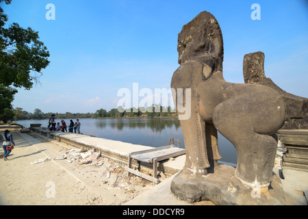 The lion statue of Angor Wat bridge in the morning - Stock Photo