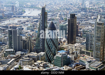 aerial view of the City of London, Gherkin, Cheese Grater and NatWest Tower plus the River Thames, business area - Stock Photo