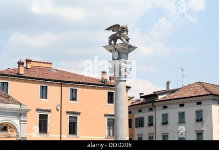 Pillar with winged lion on piazza della Liberta in Udine - Stock Photo