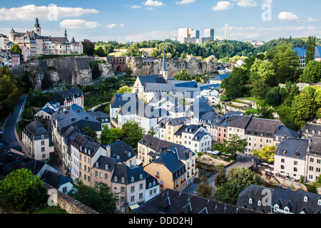 View over the Grund towards the medieval Ville Haute on the left and the modern Kirchberg district of Luxembourg - Stock Photo