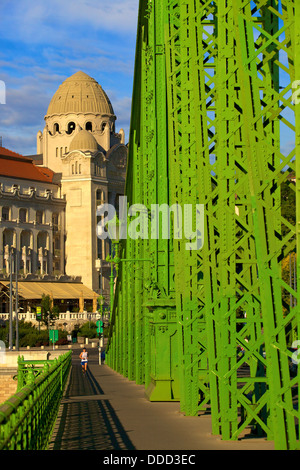 Jogger on Liberty Bridge, Gellert Hotel and Spa in Background, Budapest, Hungary, East Central Europe - Stock Photo
