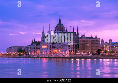 Side view of the beautiful historic Hungarian parliament building at early dawn - Stock Photo