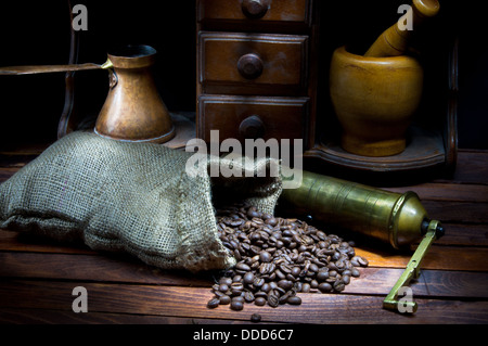 Vintage coffee grinder and cezve with roasted coffee beans - Stock Photo