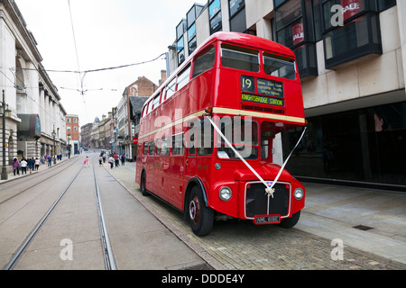 Red London bus double decker old antique classic used for wedding on street of Nottingham City Centre Nottinghamshire - Stock Photo