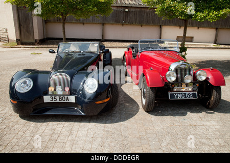 A pair of Morgan sports cars, a modern Aero 8 sports coupe, and an older Morgan, at an owners club rally, Lambourn, - Stock Photo