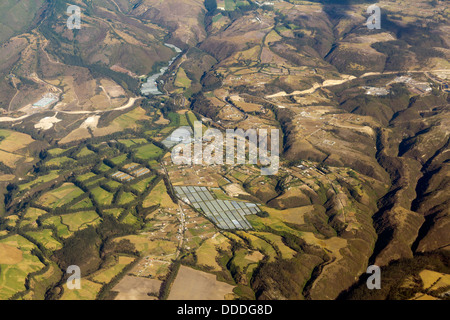 Aerial view of Cayambe in the Ecuadorian Andes showing greenhouses used for rose cultivation - Stock Photo