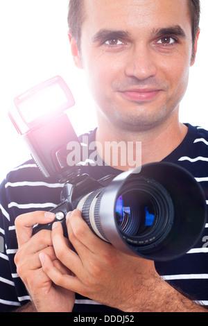Portrait of photographer holding professional camera. - Stock Photo