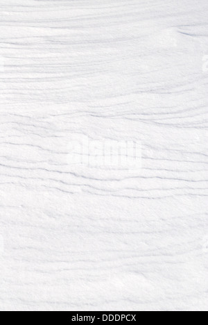 Fresh white snow background texture showing contours and layers. - Stock Photo