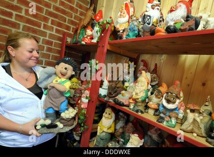 Aline Eppinger poses with a hedgehog figure at her 'Garden Gnome Hospital' in Velpke, Germany, 22 August 2013. The - Stock Photo